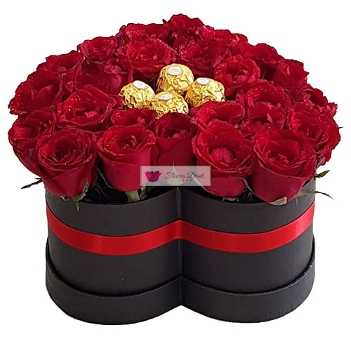 Heart Box of Roses (Red) with Ferrero Chocolate Candy. 30-36 short stem red roses in a black heart shaped box with four pieces of Ferrero.