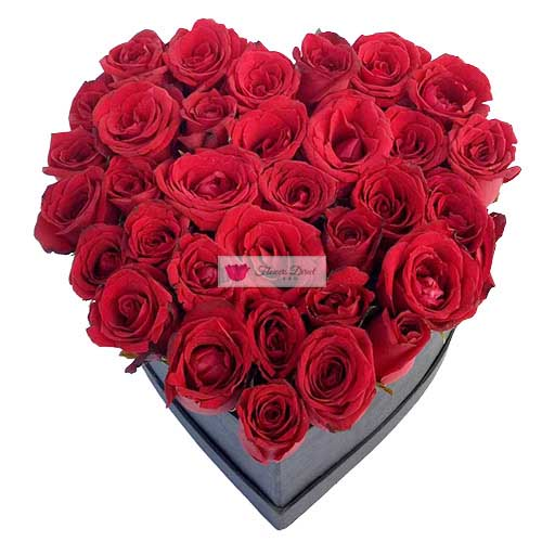 Heart of Roses Cebu 30 - 36 short stem red roses in a black heart shaped box.