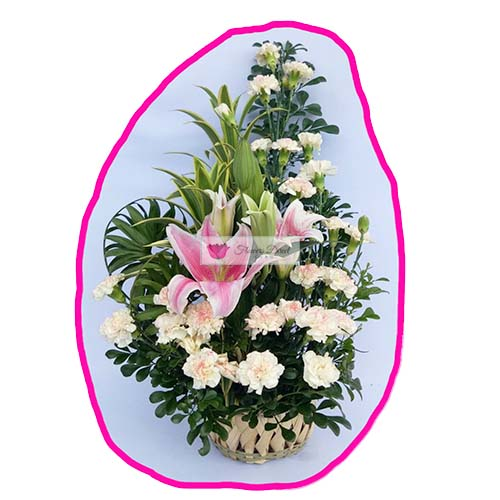 Carnation Lilium Cebu Mix White carnation flowers and liliums along with a mix of greens in a handmade basket.