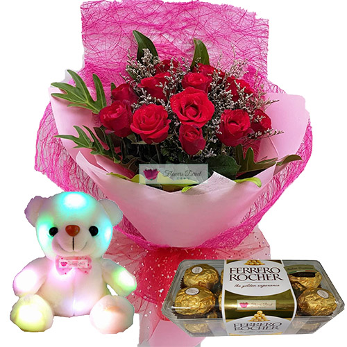 "Online Flowers Cebu Gift set includes a nice bouquet of 12 roses wrapped, 8"" Light up bear and 16ct Ferrero. Rose can be white, pink or red just let us know when ordering."