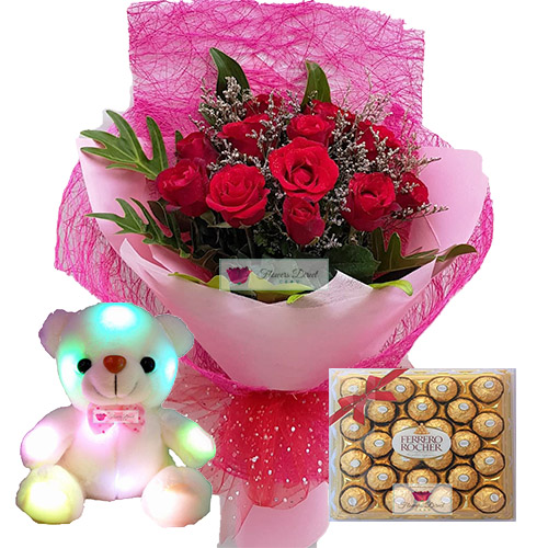 "Combo Cebu  includes a nice bouquet of 12 roses in a wrap, 8"" Light up bear and 24ct Ferrero. Rose can be white, pink or red just let us know when ordering."