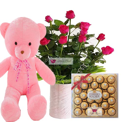 "SM Flower Shop Cebu Package Cebu includes a nice bouquet of 12 roses in a vase, 24"" Light up bear and 24ct Ferrero. Rose can be white, pink or red just let us know when ordering."