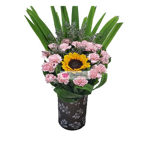 Courting Flowers Cebu pink carnation flower with a sunflower in the middle all in a black vase