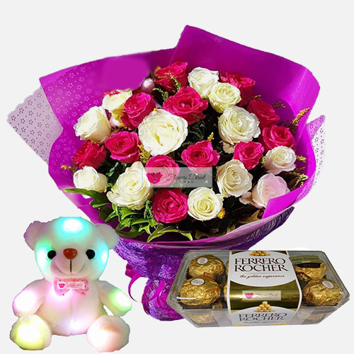 "Flowers Package Cebu includes a nice bouquet of 24 roses wrapped, 8"" Light up bear and 16ct Ferrero. Rose can be white, pink or red just let us know when ordering."