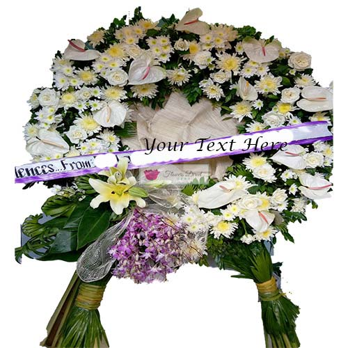 Sympathy Flowers Cebu #4 , is a beautiful mix of flowers in a circle shape design on a stand. The circle is about 3 feet tall and the overall stand is about 5 feet tall. This can be customized to the shape and colors of your choice. You may also add a ribbon of text, just let us know in the comments section when ordering.