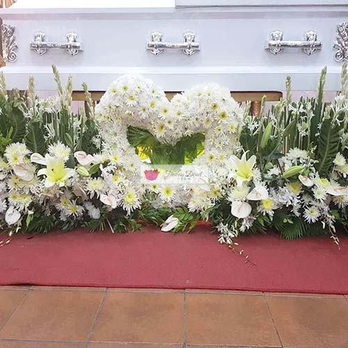 Funeral Package Cebu includes the sympathy heart of flowers and flowers to cover the front of the casket. Package can be customized to your specification and budget, just let us know.