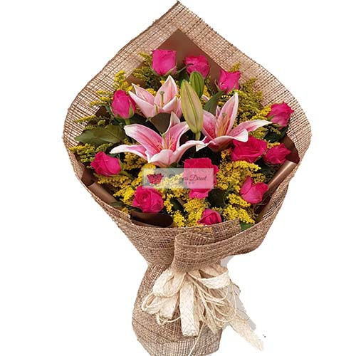 Roses Lilium Cebu 12 pink roses lilium flowers in a wrap. Roses Lilium 5 star service with delivery and satisfaction guaranteed.