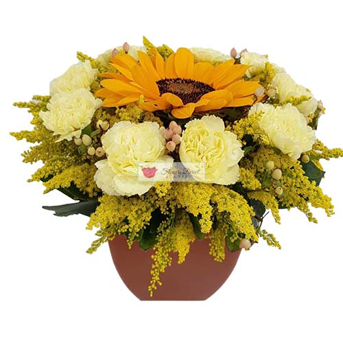 SunBurst Flowers Cebu. Combination of Sunflower, carnation and accent Flowers in a hard plastic vase.