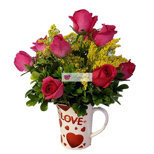 "Pink roses cup deluxe Cebu, one dozen pink roses in a 4"" coffee cup with yellow accent."