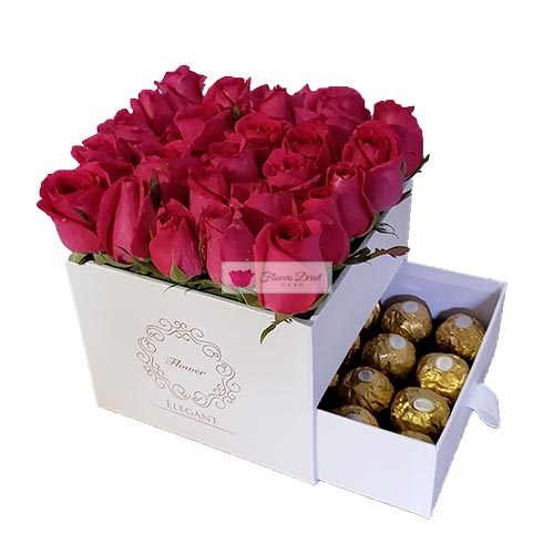 Roses Gift Box Cebu with 16 count Ferrero. Choose Black or White box. 20-24 Pink roses in a decorative box that includes 16 pieces of ferrero chocolate candy. All orders receive a free customized greeting card. Provide card message at checkout.