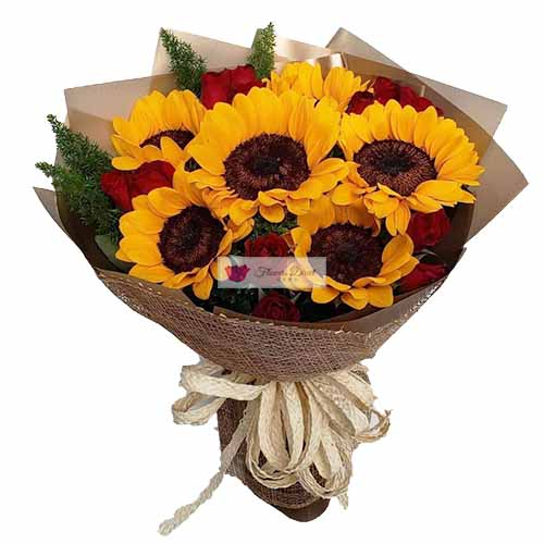 Sunflowers and roses Cebu  is a bouquet of six imported sunflowers and a dozen red roses in a nice wrap.   All orders receive a free customized greeting card. Provide card message at checkout.