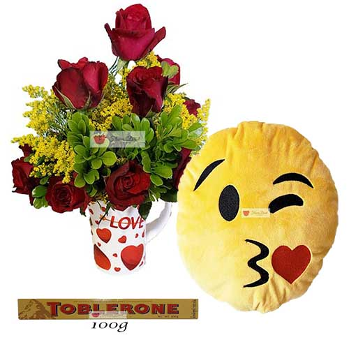 "Cebu Love Flowers includes; 12 Red Roses in a 4"" reusable coffee cup. 12"" Emoji Pillow 100 gram Toblerone"