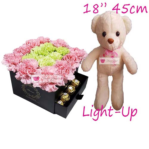 "Anniversary Flowers Cebu includes 19 carnations in a gift box, 18"" Light up bear and 16ct Ferrero."