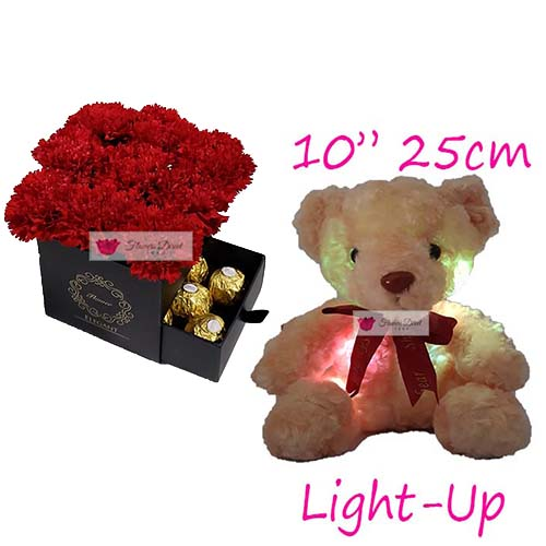 Floral Design Cebu Anniversary Flowers in Cebu includes 9 carnation in a gift box, 10″ Light up bear and 8ct Ferrero