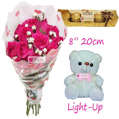 "Budget Gift Cebu includes; 12 Pink Roses in a plastic decorated wrapper.  8"" Light up bear 5pc Ferrero Default is pink roses, let us know when ordering if you would like red roses for the same price."
