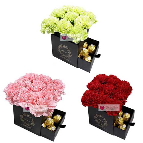 Carnation Gift Box Cebu, 9pc Pink or Green or Red with 6ct Ferrero Carnation Gift Box Cebu comes with 9 carnation flowers in pink, green or red and 6 count Ferrero in a black gift box.