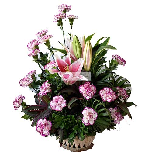 Carnation Lilium Basket Cebu Mix Mix of white with purple accent in a basket. All orders receive a free customized greeting card. Provide card message at checkout.