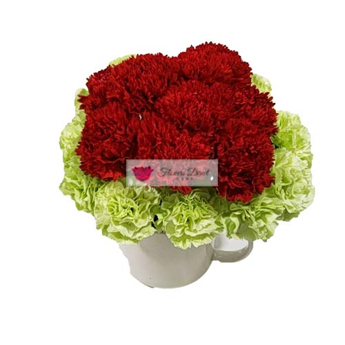 "Carnations Cebu cup in a Reusable 4"" coffee cup. 20  green and red carnations Cebu flowers for delivery. Coffee cup color will vary depending on stock."
