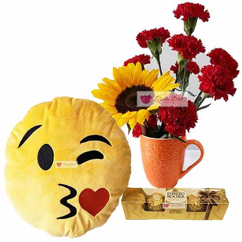 "Cebu Anniversary Flowers includes; 10 Red Carnations and a sunflower in a 4"" reusable coffee cup"
