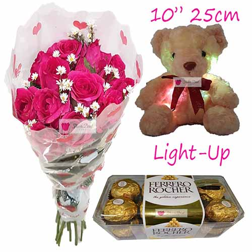 "Courtship Gift Cebu includes; 12 simple pink roses 10"" Brown light up bear 16pc Ferrero Roses available in Pink or Red."