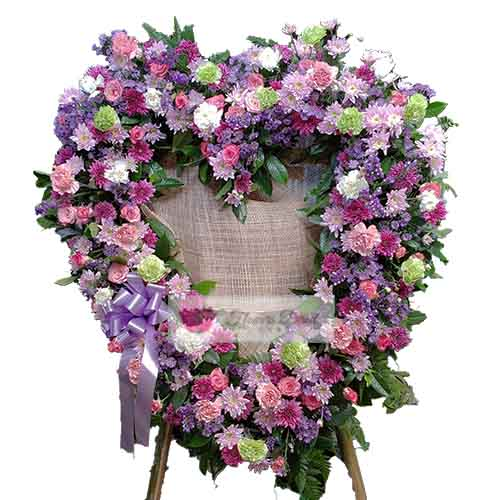 Funeral Flowers Cebu #5 , is a beautiful mix of flowers (carnation, rose, status, mums) in a heart shape design on a stand. The heart is about 3 feet tall and the overall stand is about 5 feet tall. This can be customized to the shape and colors of your choice. You may also add a ribbon of text, just let us know in the comments section when ordering.
