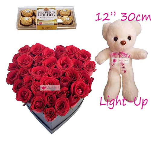 "Flower Heart Box Cebu includes; 3 dozen red roses in a heart shape box with 8ct Ferrero and a huge 12"" light up bear."