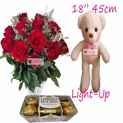 "Love Flowers Cebu includes a nice bouquet of 12 roses in a vase, 18"" Light up bear and 16ct Ferrero."