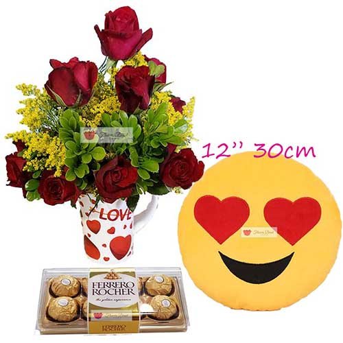"Valentines Day Gift Cebu includes; Red roses cup deluxe, 12 red roses in a love theme 4"" coffee cup 12"" Love face emoji pillow 8pc Ferrero Roses available in Pink or Red."