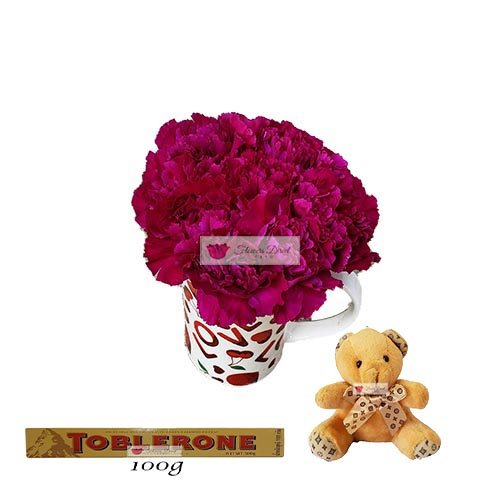 Discount Flower Bouquet Cebu 10 carnations of your color choice in a love themed coffee cup with 4 inch bear and 100 gram Toblerone. Picture is shown with Violet carnations.