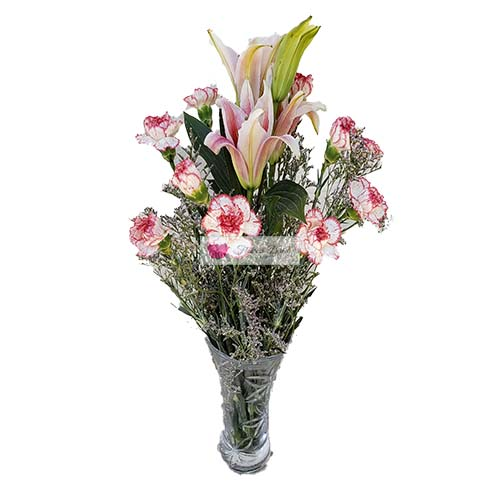 Pink Lily Carnations Vase Cebu 10 white/pink carnations and 1 stalk of 4 pink lily flowers in a clear glass vase.