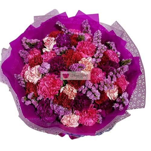 Purple Flower Bouquet Cebu 40 Purple/Violet themed carnations in a vase or wrap.