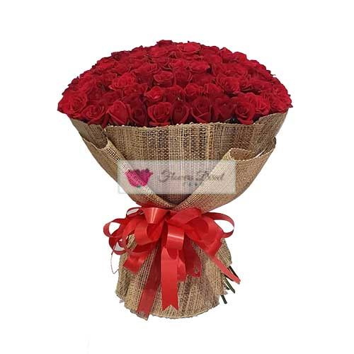 100 Roses, 100 Red Roses in a wrap with no green or filler. Also available in Pink Roses.